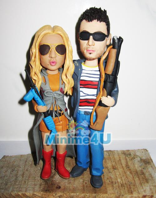 couple with shotguns cake topper