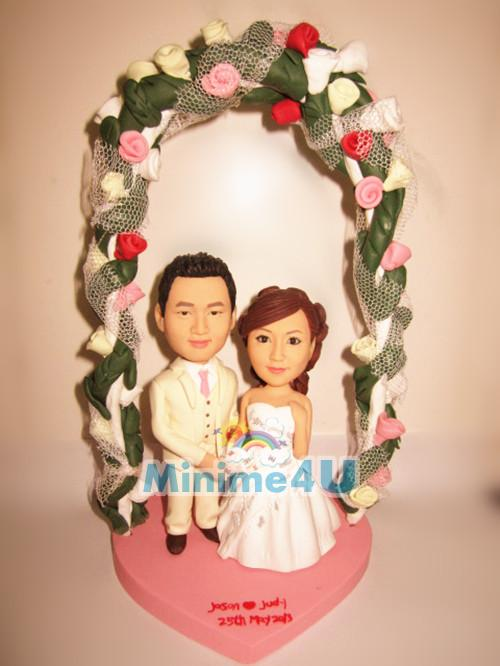 wedding cake topper with flower arch