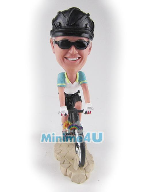riding bike figurine