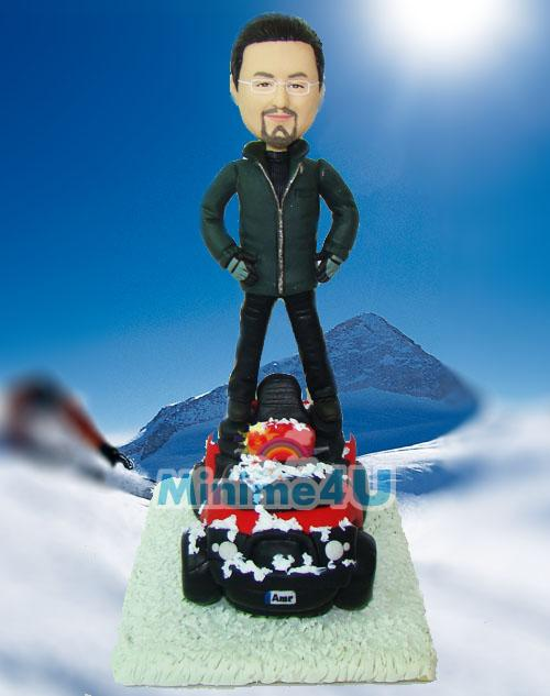 Snowmobile driver figurine